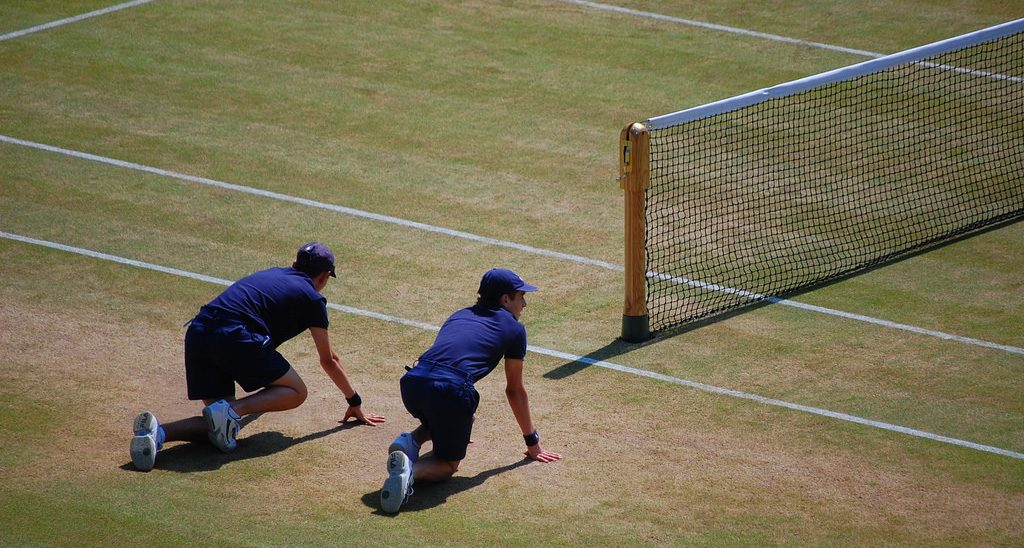 Two ball boys in action
